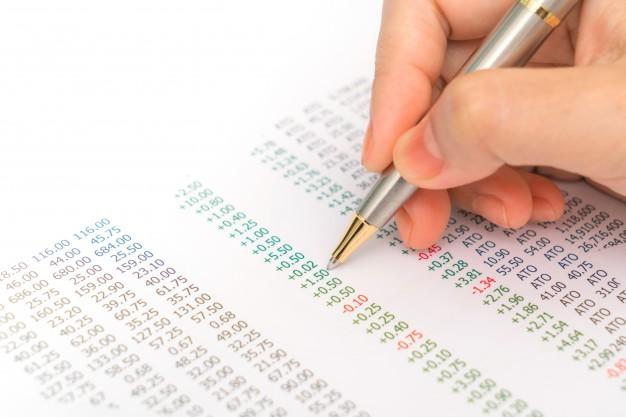 business woman hand with financial charts and laptop on the ta 1232 3514 - سازمان امورمالیاتی و بررسی حسابهای بانکی