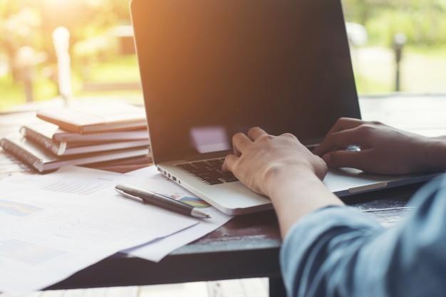 business woman hand typing on laptop keyboard with financial cha 1150 725 - بهترین نرم افزار حسابداری چه ویژگی هایی دارد؟