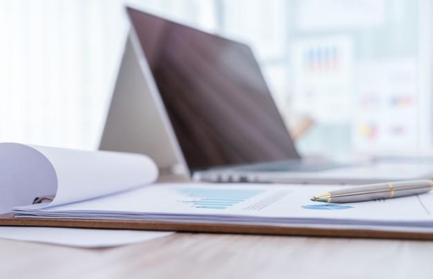 financial charts on the table with laptop 1232 2737 - ?منظور از طبقه بندی هزینه ها بر اساس ارتباط آنها با تولید محصول چیست؟